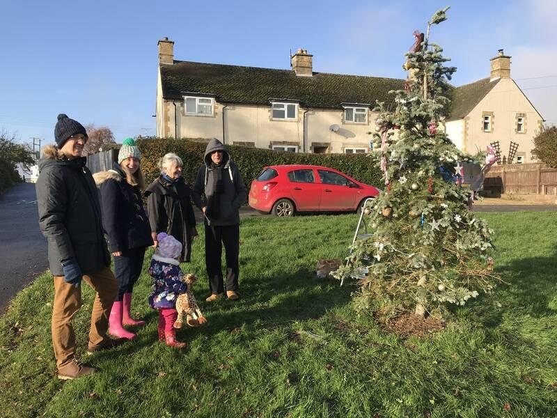 Christmas tree decorates village green